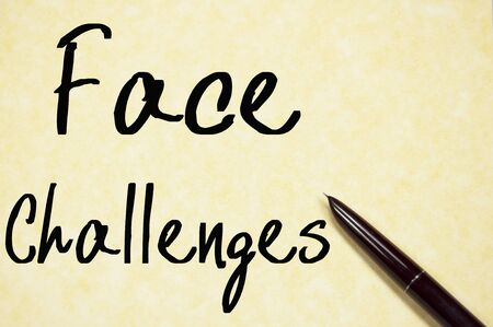 appease: face challenges text write on paper
