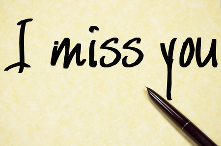 i miss you: I miss you text write on paper