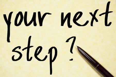 the next step: your next step text write on paper Stock Photo