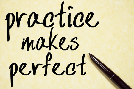 perfect: practice makes perfect text write on paper