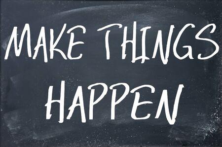 schoolroom: make things happen text write on blackboard Stock Photo