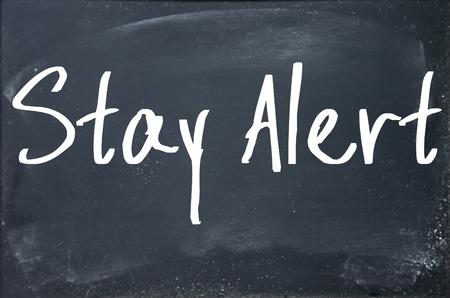 stay alert: stay alert text on blackboard