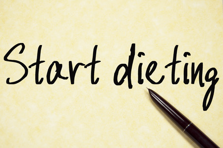 dieting: start dieting text write on paper
