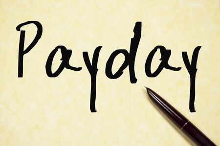 payday: payday word write on paper