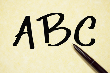 indeed: ABC word write on paper Stock Photo