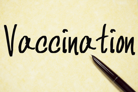 vaccination: vaccination word write on paper