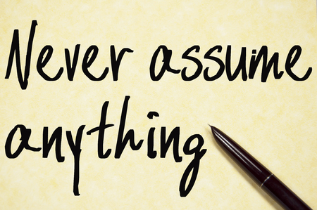 assume: never assume anything text write on paper