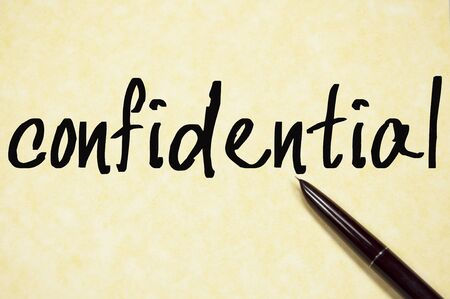 confidential word write on paper Stock Photo
