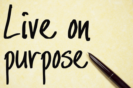 live on purpose text write on paper
