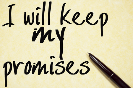 Terrò le mie promesse scrivono su carta Archivio Fotografico