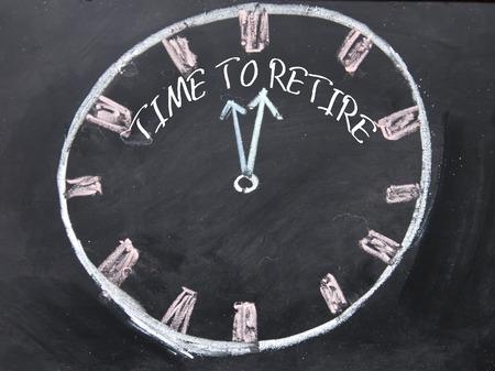 retire: time to retire text write on blackboard Stock Photo