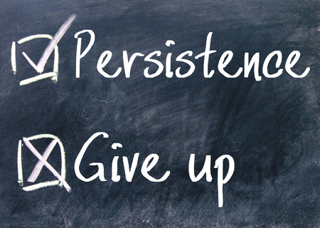 surety: persistence or give up choice on blackboard Stock Photo