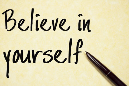 believe in yourself: believe in yourself text write on paper