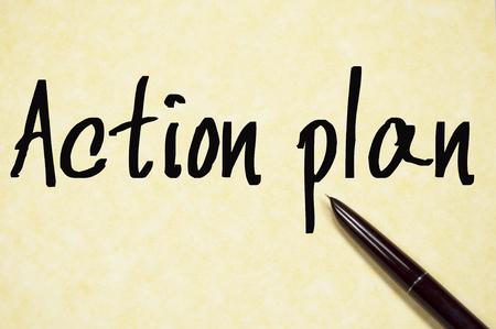 plan de accion: action plan text write on paper