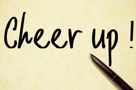 cheer up text write on paper Stock Photo