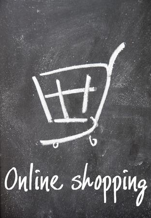 detriment: online shopping sign on blackboard Stock Photo