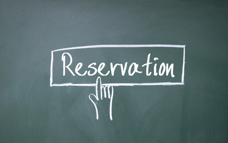 scheduled: abstract finger click reservation sign on blackboard
