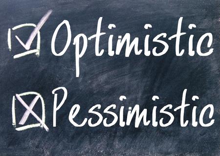 pessimistic: optimistic and pessimistic choice on blackboard Stock Photo
