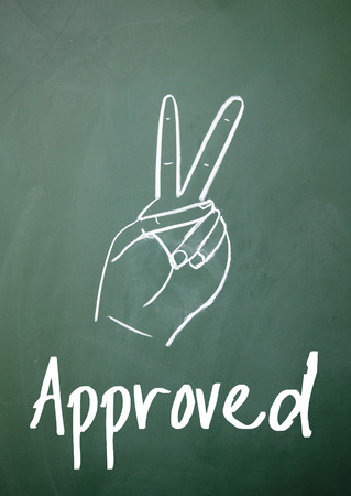 approved sign: approved sign on blackboard