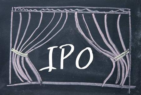 initial public offerings: IPO word and curtain background on blackboard Stock Photo
