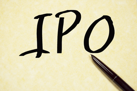 initial public offerings: IPO sign on whiteboard