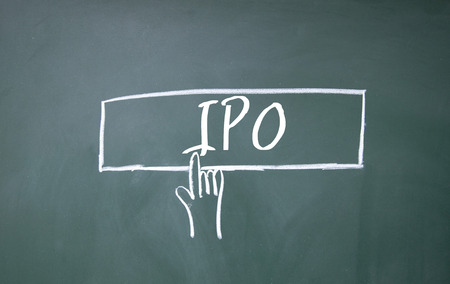 initial public offerings: abstract finger click IPO sign on blackboard Stock Photo
