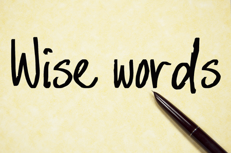 sagacious: wise word sign on paper