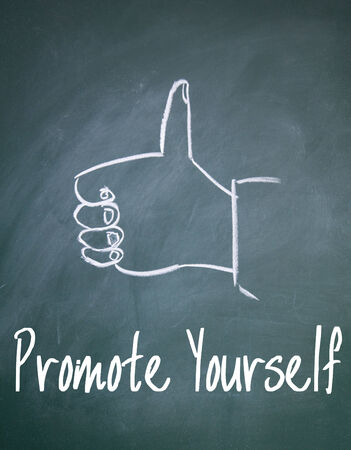 promote: promote yourself sign on blackboard Stock Photo
