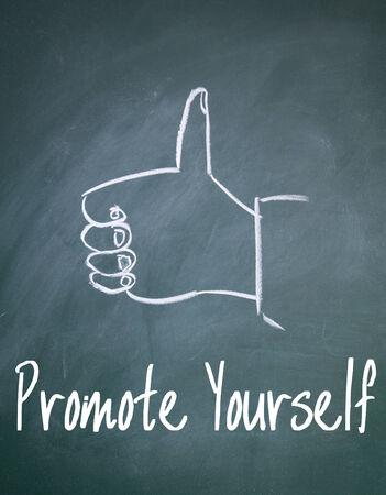 promote yourself sign on blackboard Stock Photo