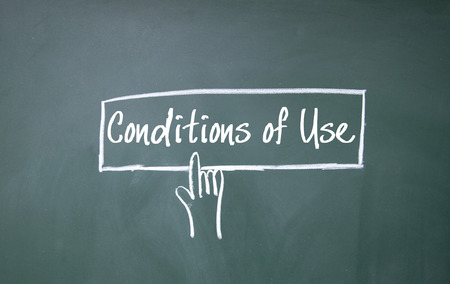 use regulations: abstract finger click conditions of use sign on blackboard Stock Photo