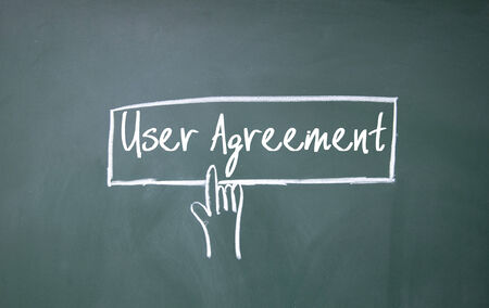 use regulations: abstract finger click user agreement sign on blackboard Stock Photo
