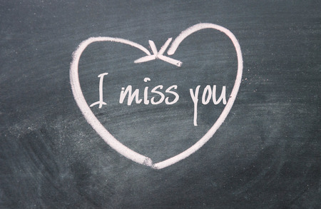 i miss you: I miss you sign on blackboard Stock Photo