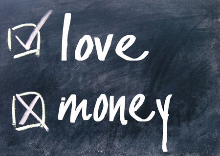love and money choice on blackboard photo