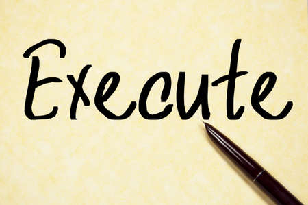 execute: execute word write on paper Stock Photo