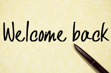 welcome back text write on paper