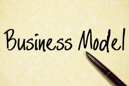 business model: business model text write on paper