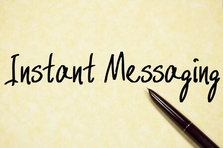 instant messaging: instant messaging text write on paper Stock Photo