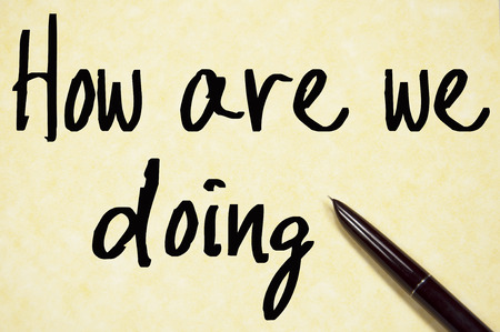 how are we doing text write on paper Standard-Bild