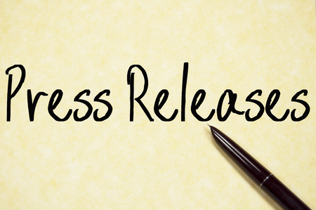 press release: press releases text write on paper Stock Photo