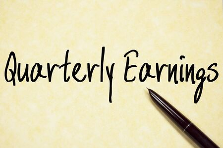 quarterly: quarterly earnings text write on paper
