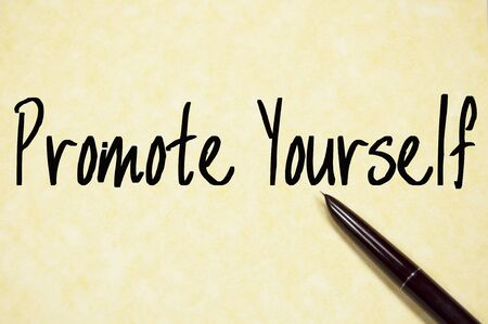 promote yourself text write on paper Stock Photo