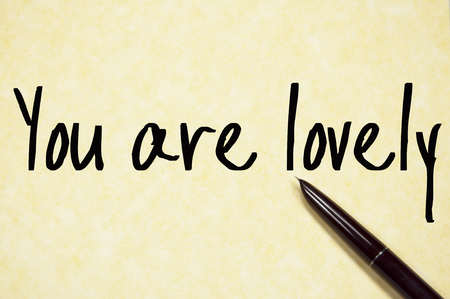 amiable: you are lovely text write on paper