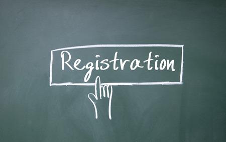 registration: abstract finger click registration sign on blackboard