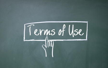 use regulation: abstract finger click terms of use sign on blackboard Stock Photo