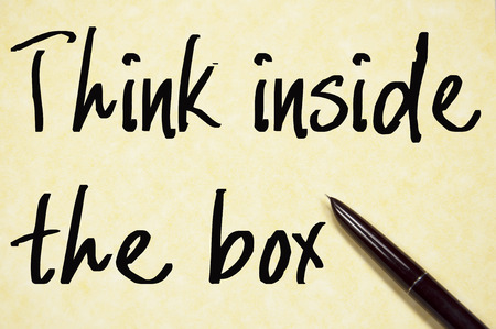 text box: think inside the box text write on paper Stock Photo