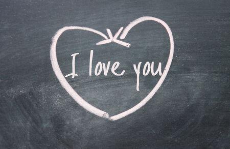 i love you sign: I love you sign on blackboard Stock Photo
