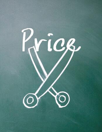 price cut: price cut sign on blackboard