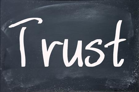 ethics: trust word write on blackboard