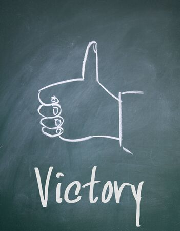 affirmed: victory word write on blackboard Stock Photo