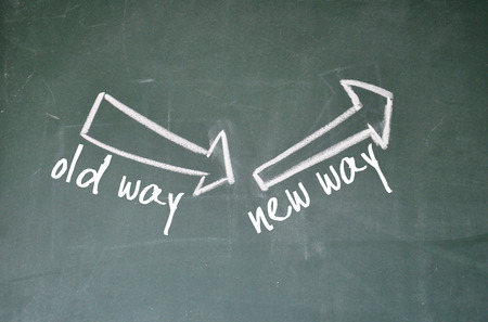 old way and new way sign on blackboard photo